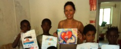 Andrea with kids - donate